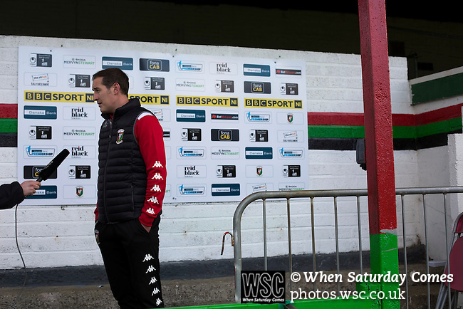 Glentoran 2 Cliftonville 1, 22/10/2016. The Oval, NIFL Premiership. Home manager Gary Haveron pictured during a television interview on the pitch at The Oval, Belfast after Glentoran hosted city-rivals Cliftonville in an NIFL Premiership match. Glentoran, formed in 1892, have been based at The Oval since their formation and are historically one of Northern Ireland's 'big two' football clubs. They had an unprecendentally bad start to the 2016-17 league campaign, but came from behind to win this fixture 2-1, watched by a crowd of 1872. Photo by Colin McPherson.