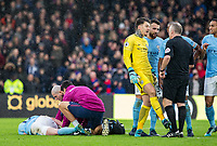 Kevin De Bruyne of Manchester City lays injured in injury time as Goalkeeper Ederson of Manchester City indicates a kick to Referee Jonathan Moss during the Premier League match between Crystal Palace and Manchester City at Selhurst Park, London, England on 31 December 2017. Photo by Andy Rowland.