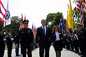 United States President George W. Bush and President of the National Fraternal Order of Police Gilbert Gallegos, left, walk past a Police Honor Guard at the 20th Annual Peace Officers Memorial Service, which pays tribute to fallen law enforcement officers 15 May 2001 on the lawn of the US Capitol.  Women on the right is unidentified.   More than 150 US police officers were killed in the line of duty last year.  <br /> Credit: Jamal A. Wilson / Pool via CNP