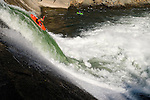 9 Year-old Sage Donnelly on the Big Bend dam slide on the North Fork of the Feather River. Kayak north feather river into lake oroville with dam slide