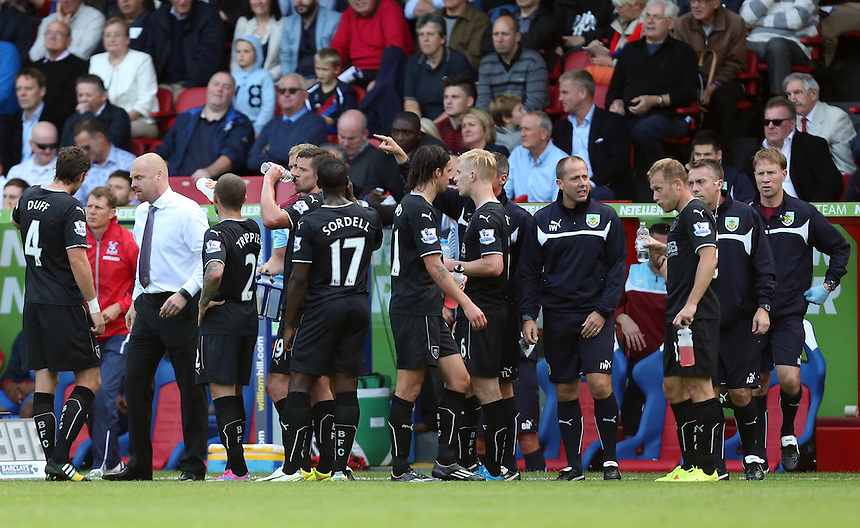 Burnley manager Sean Dyche  with his players for a drink break<br /> Photographer Kieran Galvin/CameraSport<br /> <br /> Football - Barclays Premiership - Crystal Palace v Burnley - Saturday 13th September 2014 - Selhurst Park - London<br /> <br /> &copy; CameraSport - 43 Linden Ave. Countesthorpe. Leicester. England. LE8 5PG - Tel: +44 (0) 116 277 4147 - admin@camerasport.com - www.camerasport.com