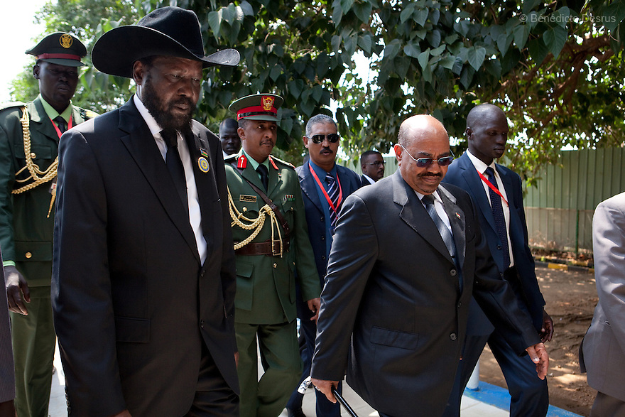 Saturday 9 july 2011 - Juba, Republic of South Sudan - South Sudan's President Salva Kiir (L) and Sudan's President Omar Hassan al-Bashir walk at Juba International airport. Al-Bashir arrives at Juba airport for the Independence Day celebrations in South Sudan's capital Juba..Photo credit: Benedicte Desrus