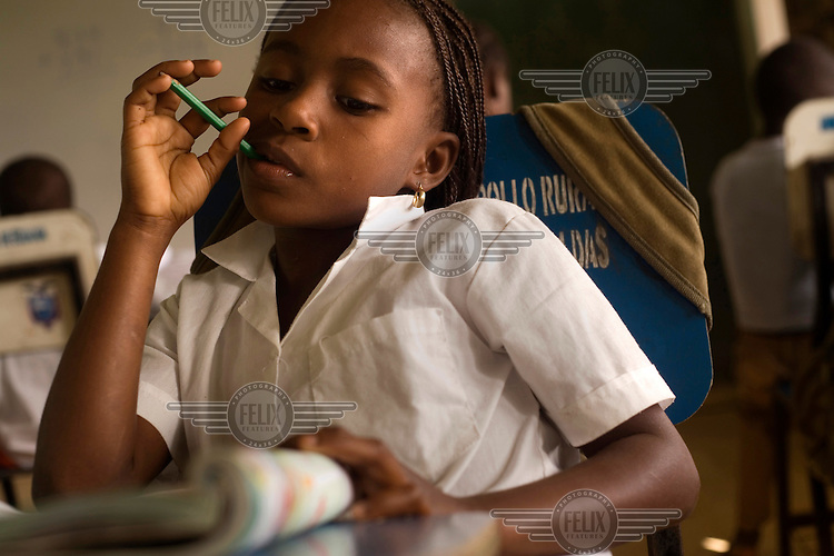 A girl studies in a class at the school in San Miguel, an Afro Ecuadorian community located three hours up the Cayapas River in the province of Esmeraldas.