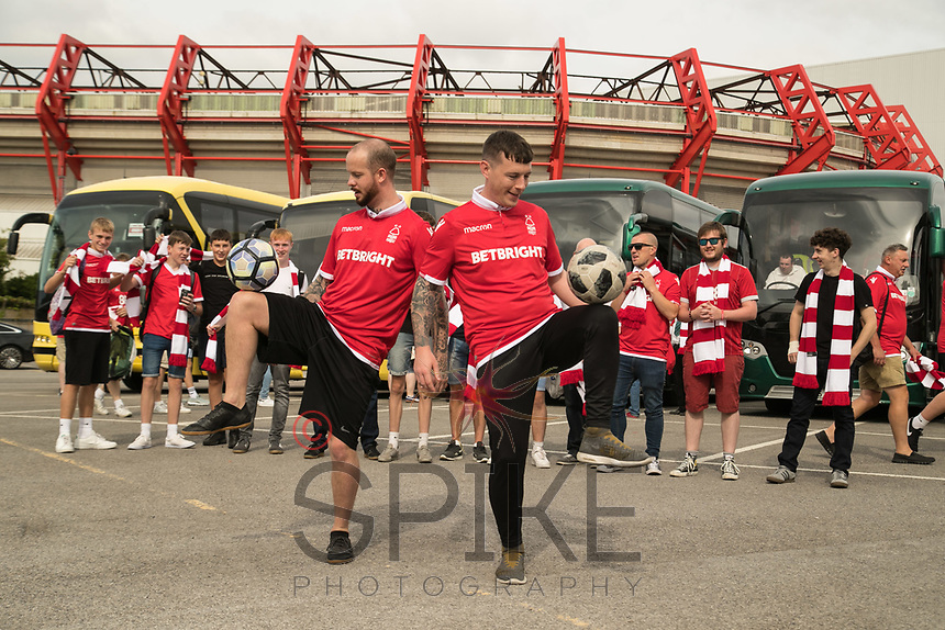 Football freestylers John Whetton and Oliver Hayes entertain the supporters before boarding the buses