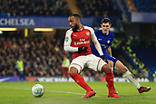 10th January 2018, Stamford Bridge, London, England; Carabao Cup football, semi final, 1st leg, Chelsea versus Arsenal; Alexandre Lacazette of Arsenal under pressure from Andreas Christensen of Chelsea
