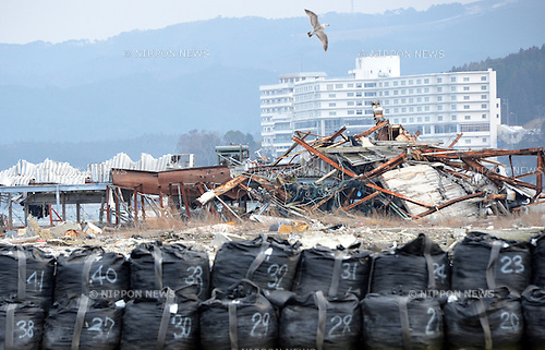 March 8, Minami-Sanriku, Japan - A seagall flies over the ruins of a building in this seaside community of Shizugawa, Miyagi Prefecture on March 8. The community located deep inside an estuary by the Pacific Ocean was destroyed when the Magnitude 9.0 earthquake and ensuing mounds of tsunami struck the nation's northeast region, leaving more than 15,000 people dead and ravaging wide swaths of coastal towns and villages two years ago on March 11.  (Photo by Natsuki Sakai/AFLO)