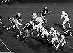 Bethel Park PA:  Offensive play with Mike Stewart 11 throwing a hook to Bruce Evanovich 80.  Others in the photo; Chip Huggins 32, Bob Hensler 77, Don Troup 51, Joe Barrett 75, Dennis Franks 66.  Good blocks by the offensive line and Clark Miller 30. The offense and defense did not play well in the 12-6 defeat vs Montour. Montour's quarterback, Jim Daniels, killed the Blackhawks.  Jim Daniels was played his college ball at Pitt.  The defensive unit was one of the best in Bethel Park history only allowing a little over 7 points a game.