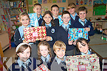 Students at Kilcummin National School in Killarney are busy putting the final touches to their shoebox appeal for children around the world at Christmas. The children are donating toys and necessities to fill the shoeboxes for the Team Hope Christmas appeal. .Back L-R Kevin Healy, Eoin Daly and Lucia Hurmson.Middle L-R Beibhinn Brosnan, Emma Lowin  Con Fleming and Lorcan O'Connor.Front L-R  Mary Murphy, Sarah O'Riordan, Darragh Fleming and Shauna O'Donoghue. .