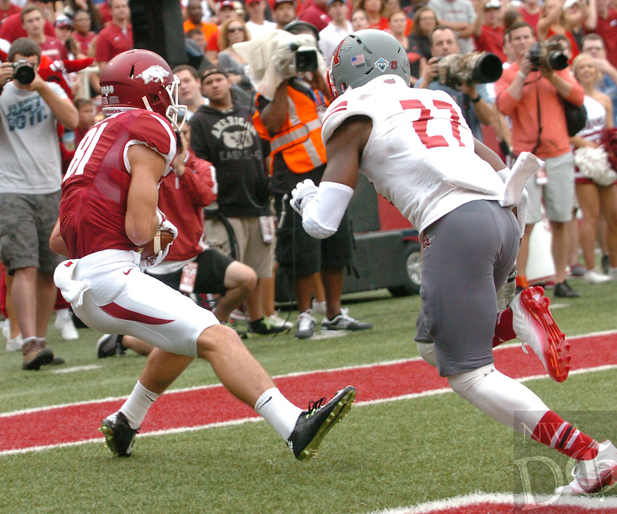 NWA Media/ANDY SHUPE - Arkansas receiver receiver Cody Hollister catches the ball in the end zone behind Nicholls defensive back Byron Cobb during the first quarter Saturday, Sept. 6, 2014, at Razorback Stadium in Fayetteville