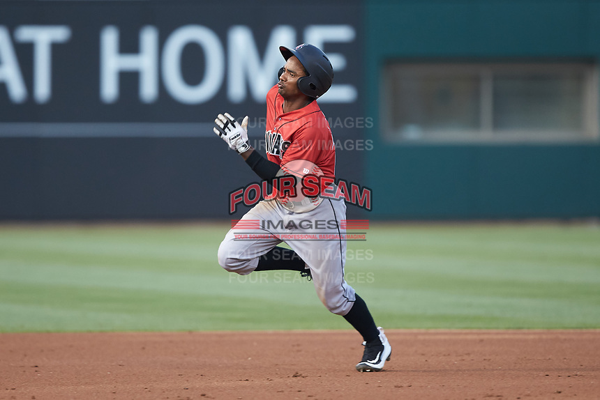 Pablo Reyes (12) of the Indianapolis Indians hustles towards third base against the Charlotte Knights at BB&T BallPark on May 26, 2018 in Charlotte, North Carolina. The Indians defeated the Knights 6-2.  (Brian Westerholt/Four Seam Images)