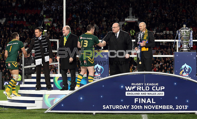 Picture by Vaughn Ridley/SWpix.com - 30/11/2013 - Rugby League - 2013 Rugby League World Cup Final - New Zealand v Australia - Old Trafford, Manchester, England - The Australia team go up onto the stage to receive their winners medals. (L-R) Billy Slater and Paul Gallen.