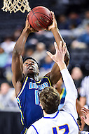 MAR 7, 2016: Baltimore, MD - North Carolina-Wilmington Seahawks forward Devontae Cacok (15) goes back up for a basket over Hofstra Pride forward Denton Koon (12) after getting the rebound during the Championship game of the CAA Basketball Tournament at Royal Farms Arena in Baltimore, Maryland. (Photo by Philip Peters/Media Images International)