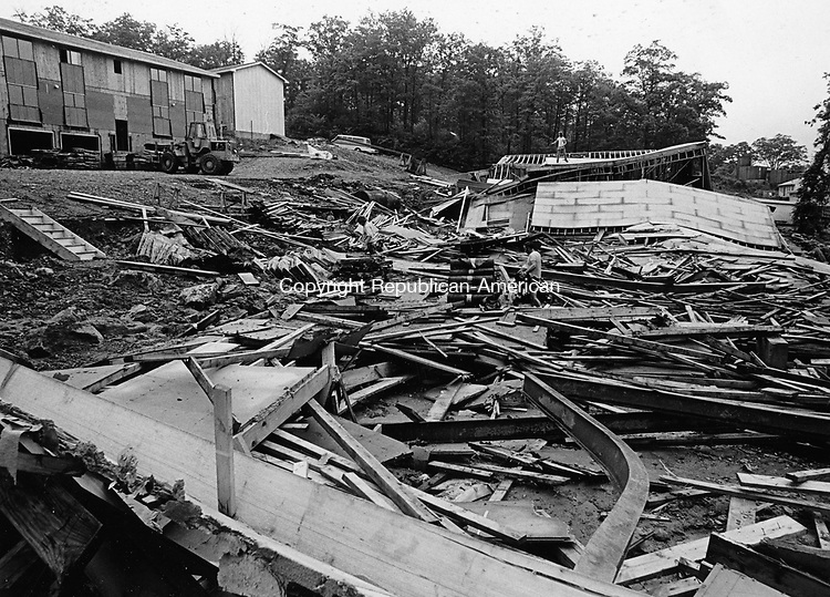 An entire wing of the Ridgeview Apartments, located at the end of Kaynor Drive in Waterbury, collapsed as a result of heavy flooding in June, 1973. Shortly before the building collapsed, a construction crew foreman sent his crew home because of poor weather conditions.