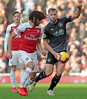 Arsenal's Mohamed Elneny vies for possession with Burnley's Charlie Taylor<br /> <br /> Photographer David Shipman/CameraSport<br /> <br /> The Premier League - Arsenal v Burnley - Saturday 22nd December 2018 - The Emirates - London<br /> <br /> World Copyright © 2018 CameraSport. All rights reserved. 43 Linden Ave. Countesthorpe. Leicester. England. LE8 5PG - Tel: +44 (0) 116 277 4147 - admin@camerasport.com - www.camerasport.com