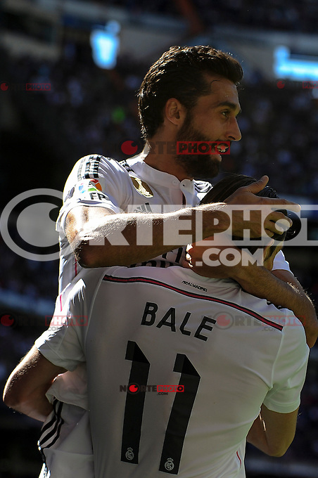 Real Madrid´s Gareth Bale and Alvaro Arbeloa celebrates a goal during 2014-15 La Liga match between Real Madrid and Granada at Santiago Bernabeu stadium in Madrid, Spain. April 05, 2015. (ALTERPHOTOS/Luis Fernandez) /NORTEphoto.com