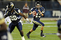 6 November 2010:  FIU quarterback Wesley Carroll (13) scrambles in the first quarter as the FIU Golden Panthers defeated the University of Louisiana-Monroe Warhawks, 42-35 in double overtime, at FIU Stadium in Miami, Florida.