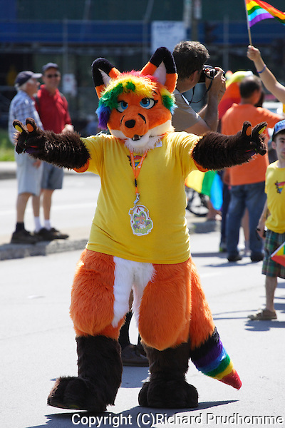 A fox mascot walking in the Pride Parade in Montreal