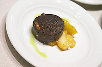 Step 3: adding a slice of fried blood sausage. The Dolly Irigoyen - famous chef and TV presenter - private restaurant, Buenos Aires Argentina, South America Espacio Dolli