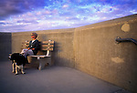 Woman sitting on bench with dog