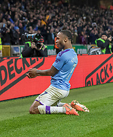 27th December 2019; Molineux Stadium, Wolverhampton, West Midlands, England; English Premier League, Wolverhampton Wanderers versus Manchester City; Raheem Sterling of Manchester City celebrates on his knees after scoring in the 50th minute 0-2