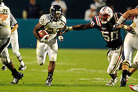 29 November 2008:  FIU running back Darriet Perry (28) evades Florida Atlantic linebacker George Allen (50) in the FAU 57-50 overtime victory over FIU in the annual Shula Bowl at Dolphin Stadium in Miami, Florida.