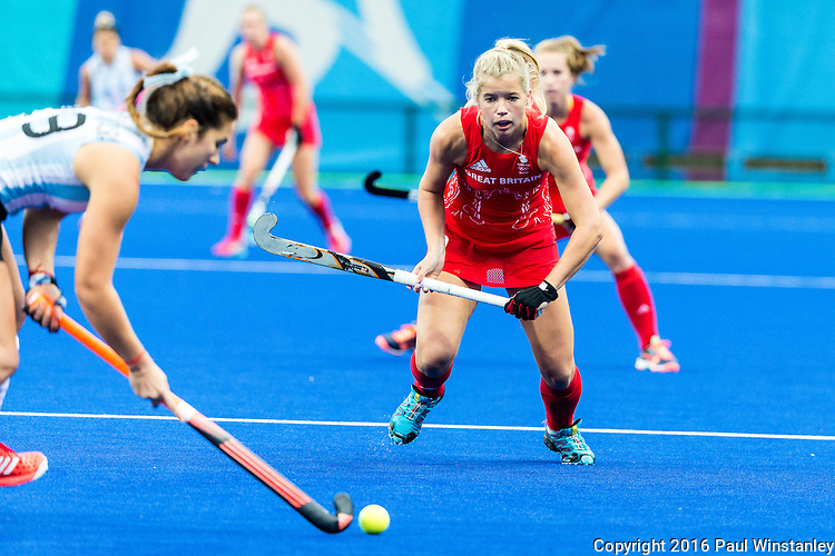 Sophie Bray #19 of Great Britain attempts to prevent the pass during Argentina vs Great Britain in women's Pool B game  at the Rio 2016 Olympics at the Olympic Hockey Centre in Rio de Janeiro, Brazil.