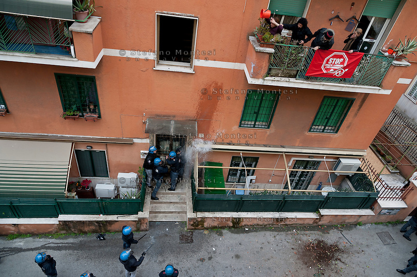 Rome, Italy. 16th February 2016<br /> Riot police It is hit by water thrown from the building where he lives Mrs. Ida with her husband who have barricaded themselves in the house to resist to eviction, to Centocelle district. The picket anti-eviction seeks to block the eviction.