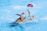 30 JUL 2012 - LONDON, GBR - Barbara Bujka (HUN) (left) of Hungary and Lauren Wenger (USA) (hidden) of the USA tangle off the ball during the teams London 2012 Olympic Games preliminary round water polo match at the Olympic Park, Stratford, London, Great Britain .(PHOTO (C) 2012 NIGEL FARROW)
