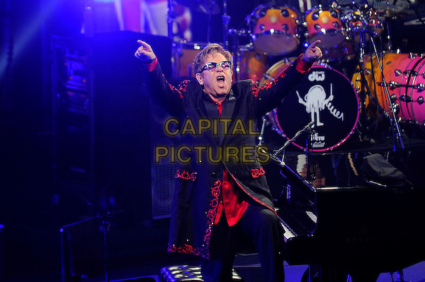 Sir Elton John <br /> performing in concert as part of the iTunes Festival, Camden Roundhouse, London, England, UK, 12th September 2013.<br /> music live on stage gig half length red black suit glasses mouth open funny piano arms raised up fingers pointing <br /> CAP/MAR<br /> &copy; Martin Harris/Capital Pictures