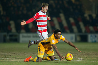 Mitch Rose of Newport County falls in the penalty area under a challenge from Conor Grant of Doncaster Rovers during the Sky Bet League 2 match between Newport County and Doncaster Rovers at Rodney Parade, Newport, Wales on 10 February 2017. Photo by Mark  Hawkins / PRiME Media Images.