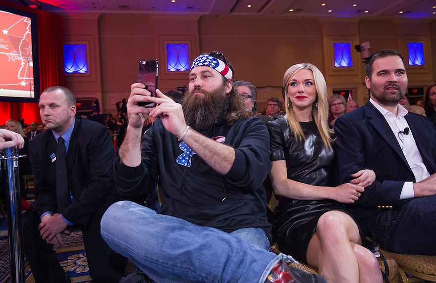 Willie Robertson, left, of popular TV show 'Duck Dynasty'   and his wife, Korie, center, watch as Phil Robertson speaks at the  annual Conservative Political Action Conference (CPAC).