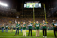 Former Green Bay Packer quarterback Don Majkowski waves to fans at Lambeau Field as his name is announced during alumni introductions prior to the Packers game against the Seattle Seahawks on Sept. 20, 2015.
