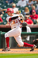 Bo Bigham #12 of the Arkansas Razorbacks follows through on his swing against the Texas Tech Red Raiders at Minute Maid Park on March 2, 2012 in Houston, Texas.  The Razorbacks defeated the Red Raiders 3-1.  Brian Westerholt / Four Seam Images