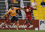 31 March 2007: New York's Jozy Altidore (r) pulls away from Houston's Brian Mullan (l). Major League Soccer's Houston Dynamo defeated the New York Red Bulls 2-1 in a preseason game at Blackbaud Stadium on Daniel Island in Charleston, SC, as part of the Carolina Challenge Cup.