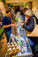 Seniors (Norwegian tourists) visiting the Sticky Buds Broadway marijuana dispensary, Denver, Colorado USA. About half of recreational marijuana sold in Colorado is bought by tourists.