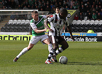 Nigel hasselbank tackled by Lewis Stevenson in the St Mirren v Hibernian Clydesdale Bank Scottish Premier League match played at St Mirren Park, Paisley on 29.4.12.