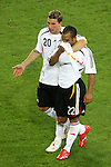 04 July 2006: Lukas Podolski (GER) (20) comforts David Odonkor (GER) after the German loss. Italy defeated Germany 2-0 in overtime at Signal Iduna Park, better known as Westfalenstadion, in Dortmund, Germany in match 61, the first semifinal game, in the 2006 FIFA World Cup.
