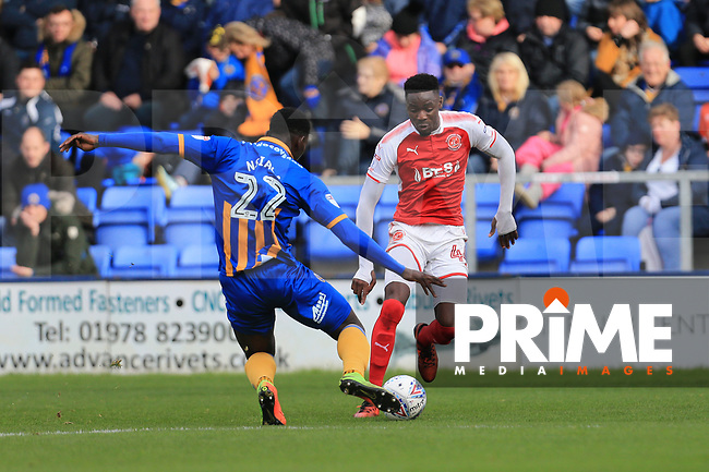 Devante Cole of Fleetwood Town wins the ball against Aristote Nsiala of Shrewsbury Town during the Sky Bet League 1 match between Shrewsbury Town and Fleetwood Town at Greenhous Meadow, Shrewsbury, England on 21 October 2017. Photo by Leila Coker / PRiME Media Images.
