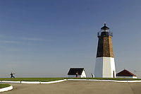 Visitors enjoy a sunny afternoon at Point Judith Lighthouse