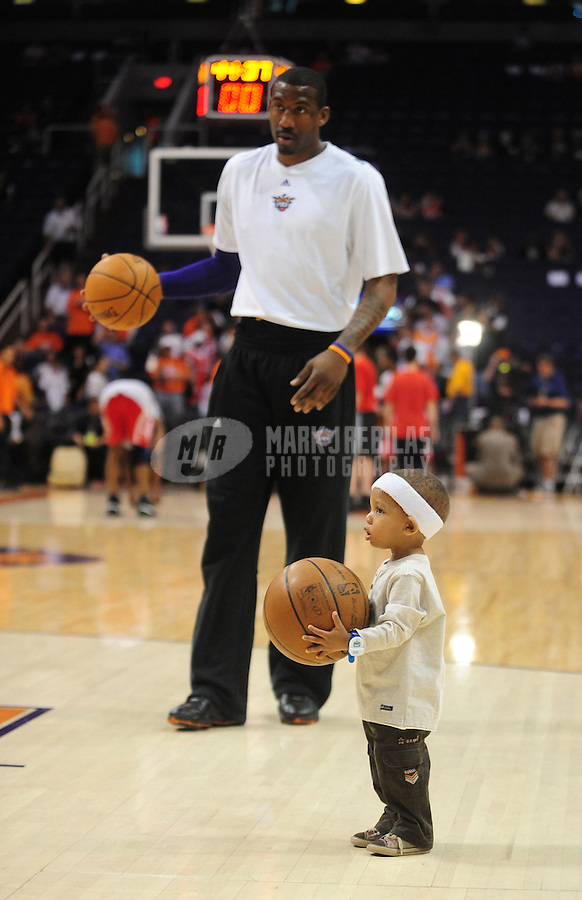 Mar. 22, 2008; Phoenix, AZ, USA; Phoenix Suns center Amare Stoudemire with son Amare Stoudemire Jr prior to the game against the Houston Rockets at the US Airways Center. Mandatory Credit: Mark J. Rebilas