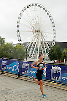 10 AUG 2014 - LIVERPOOL, GBR - Race leader Sophie Coldwell starts the run during the elite women's race at the Tri Liverpool triathlon in Kings Dock, Liverpool, Great Britain (PHOTO COPYRIGHT © 2014 NIGEL FARROW, ALL RIGHTS RESERVED)