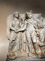 "Roman Sebasteion relief sculpture of emperor Claudius and Agrippina, Aphrodisias Museum, Aphrodisias, Turkey.  Against an art background.<br /> <br /> Claudius in heroic nudity and military cloak shakes hands with his wife Agrippina and is crowned by the Roman people or the Senate wearing a toga. The subject is imperial concord with the traditional Roman state. Agrippina holds ears of wheat: like Demeter goddess of fertility. The emperor is crowned with an oak wreath, the Corona civica or ""citizen crow"", awarded to Roman leaders for saving citizens lives: the emperor id therefore represented as saviour of the people."
