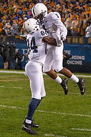 Penn State wide receiver KJ Hamler (1) and Juwan Johnson (84) celebrate Hamler's 32-yard touchdown run. The Penn State Nittany Lions defeated the Pitt Panthers 51-6 on September 08, 2018 at Heinz Field in Pittsburgh, Pennsylvania.