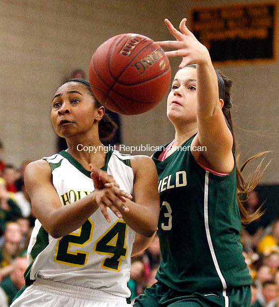 Waterbury, CT- 10 March 2015-031015CM13-  Holy Cross' RaShana Siders, left, dishes off a pass against Enfield's Hannah Lempitsky during their state tournament matchup in Waterbury on Tuesday.   Cross fell to Enfield, 45-38. Christopher Massa Republican-American