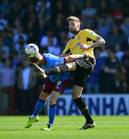 Bolton Wanderers' Mark Beevers vies for possession with Scunthorpe United's Paddy Madden<br /> <br /> Photographer Chris Vaughan/CameraSport<br /> <br /> The EFL Sky Bet League One - Scunthorpe United v Bolton Wanderers - Saturday 8th April 2017 - Glanford Park - Scunthorpe<br /> <br /> World Copyright &copy; 2017 CameraSport. All rights reserved. 43 Linden Ave. Countesthorpe. Leicester. England. LE8 5PG - Tel: +44 (0) 116 277 4147 - admin@camerasport.com - www.camerasport.com