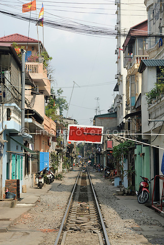 Asia, Vietnam, Hanoi. Railway track leading through Hanoi's centre.