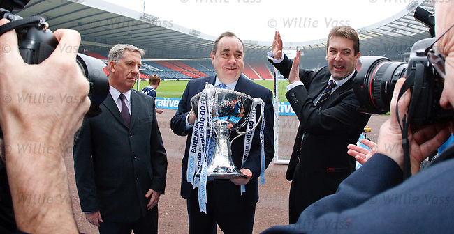 Alex Salmond shines brightly and David Longmuir of the SFL has to look away ans shield his eyes as the Co-Operative Insurance Cup is paraded at Hampden