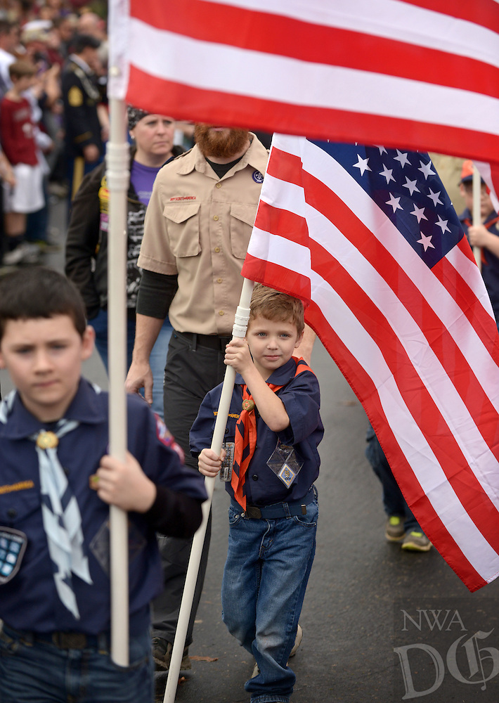 NWA Democrat-Gazette/BEN GOFF @NWABENGOFF<br /> Cub scouts take part in the procession on Saturday Dec. 12, 2015 during the Wreaths Across America ceremony at Fayetteville National Cemetery. Family members and volunteers with various veterans and community groups helped place a balsam remembrance wreath on the grave of each veteran at the cemetery as part of National Wreaths Across America Day.