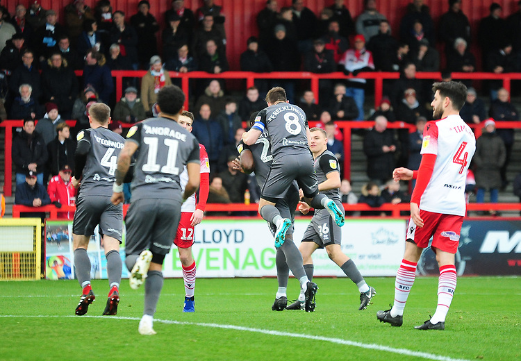 Lincoln City's Lee Frecklington jumps on John Akinde to celebrate the opening goal<br /> <br /> Photographer Andrew Vaughan/CameraSport<br /> <br /> The EFL Sky Bet League Two - Stevenage v Lincoln City - Saturday 8th December 2018 - The Lamex Stadium - Stevenage<br /> <br /> World Copyright © 2018 CameraSport. All rights reserved. 43 Linden Ave. Countesthorpe. Leicester. England. LE8 5PG - Tel: +44 (0) 116 277 4147 - admin@camerasport.com - www.camerasport.com