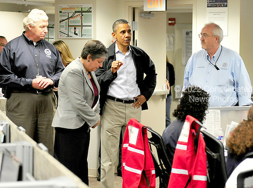 United States President Barack Obama visits the National Response Coordination Center (NRCC) at FEMA Headquarters in Washington, D.C. on Saturday, August 27, 2011 to monitor the federal response to damage caused by Hurricane Irene.  From left to right: Richard Serino, Deputy FEMA Administrator; U.S. Secretary of Health and Human Services Janet Napolitano; President Obama; FEMA Administrator Craig Fugate..Credit: Ron Sachs / Pool via CNP